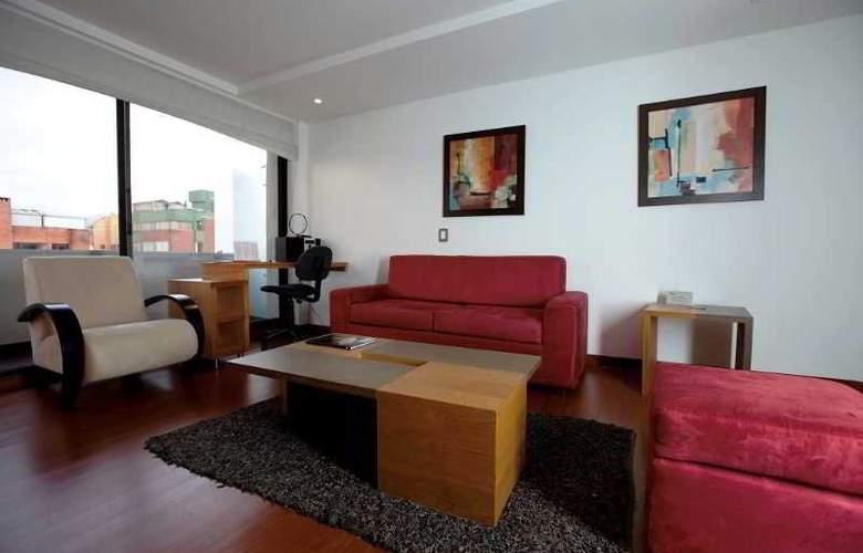 Travelers Apartamentos y Suites Obelisco - Room - 3