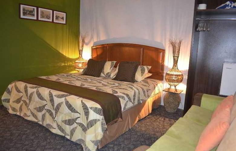 Rasa Eksotika Vacation Home - Room - 11