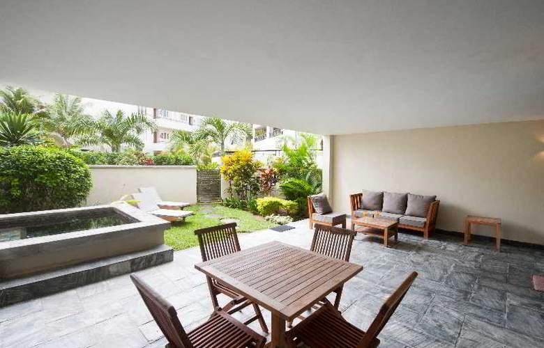 Cape Bay Luxury Beach Apartments By BARNES - Room - 12