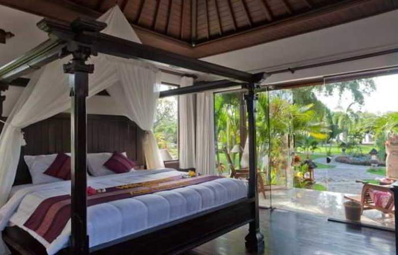 Adi Assri Beach Cottages Singaraja - Room - 15