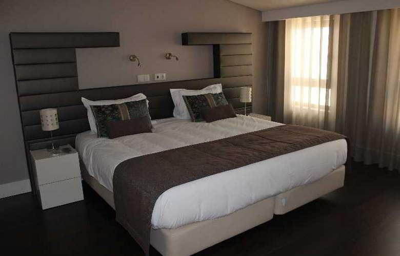 Aqua Ria Boutique Hotel - Room - 5