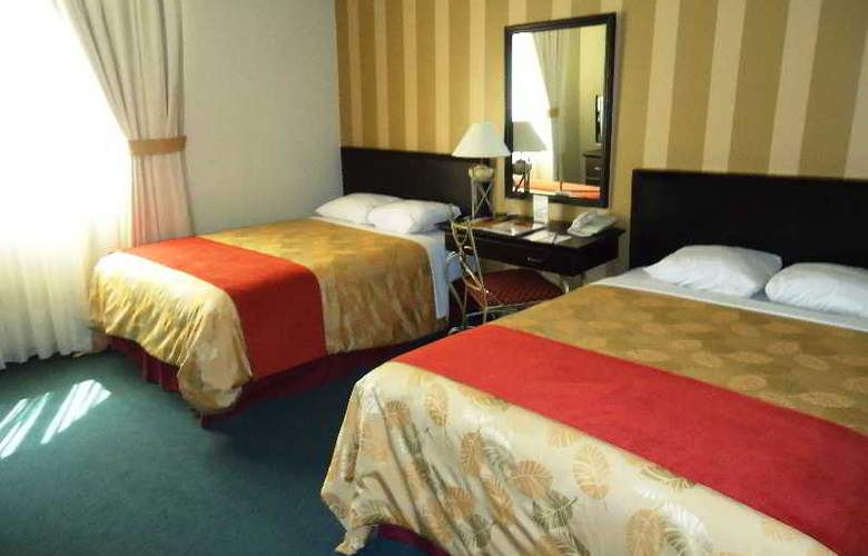 Leon de Oro Inn and Suites - Room - 4