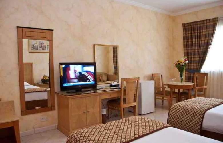 Ramee Hotel Apartment Dubai - Room - 2