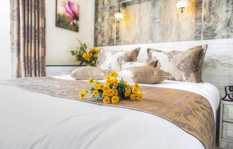 Elegance Asia Hotel - Room - 15