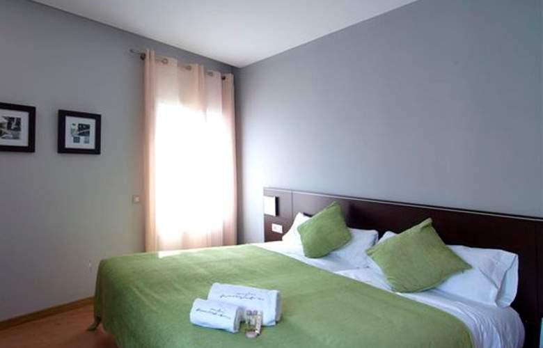 Amister Apartamentos - Room - 2