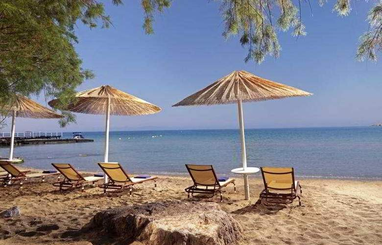 Divani Apollon Palace and Spa - Beach - 4