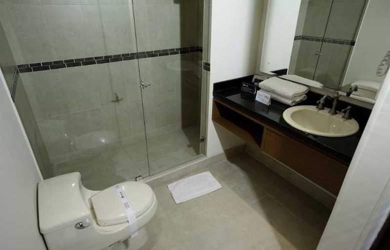 Travelers Apartamentos y Suites CondominioPlenitud - Room - 9