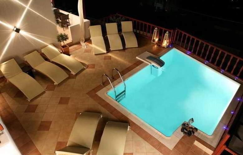 Amerisa Suites - Hotel - 0