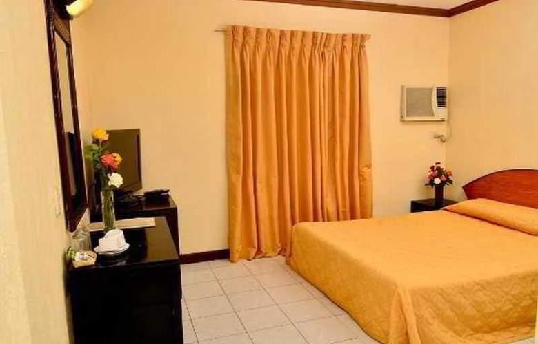 Paragon Suites - Room - 13
