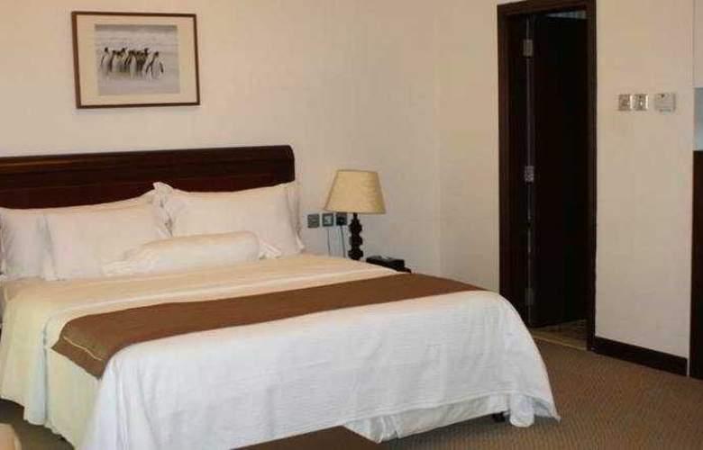 Siji Hotel Apartments - Room - 9
