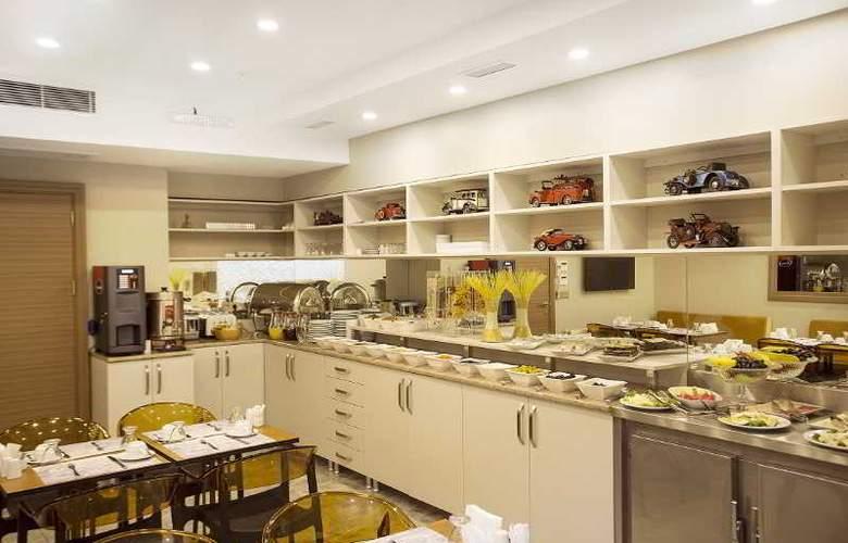 Taximist Hotel - Restaurant - 1