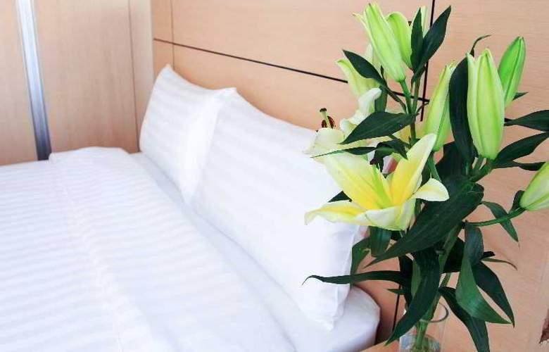 Petals Inn - Room - 9