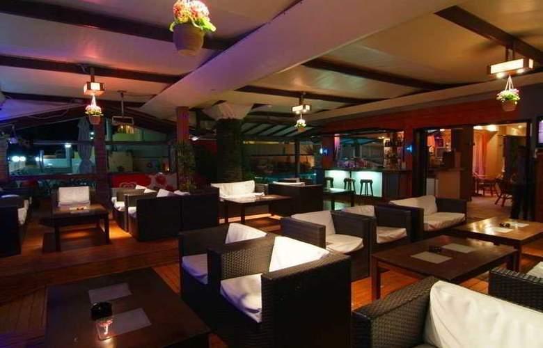 Olga's Apartments - Bar - 8