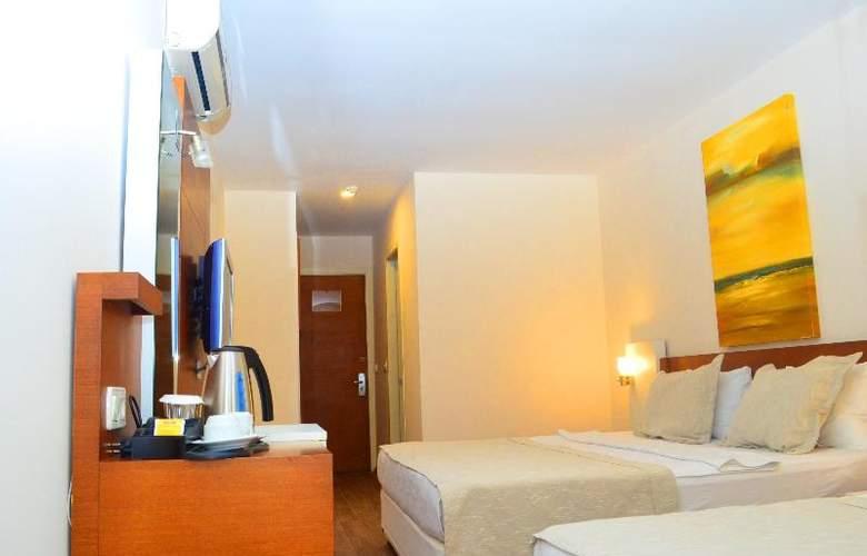 Sunbird Apart Hotel - Room - 4