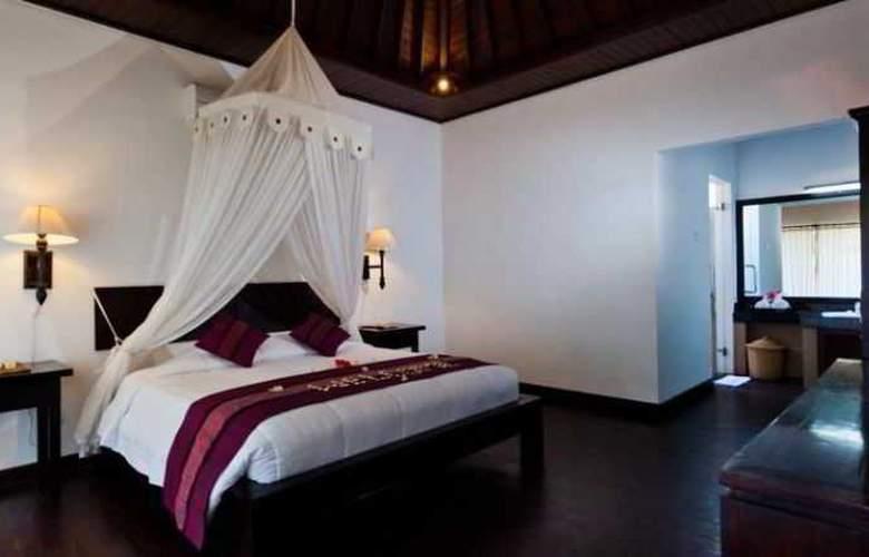 Adi Assri Beach Cottages Singaraja - Room - 19
