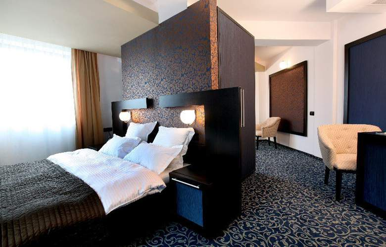 Ambiance Hotel - Room - 4