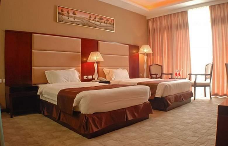 Sunlight Guest Hotel - Room - 6
