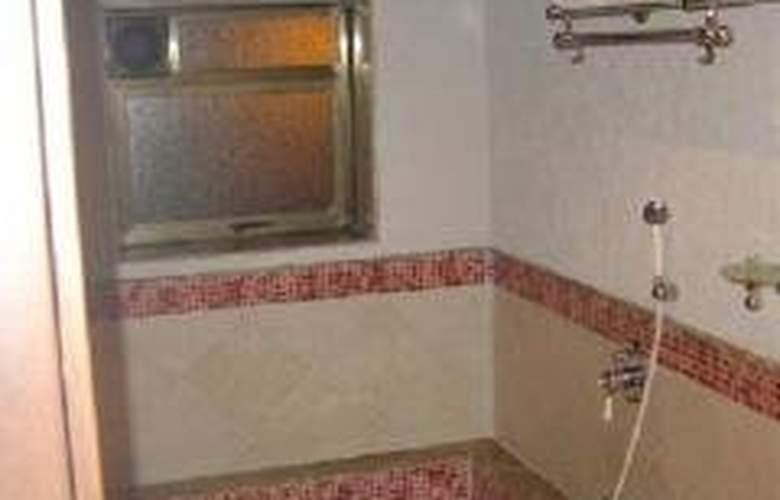 Lazylagoon Sarovar Portico Suites - Room - 0