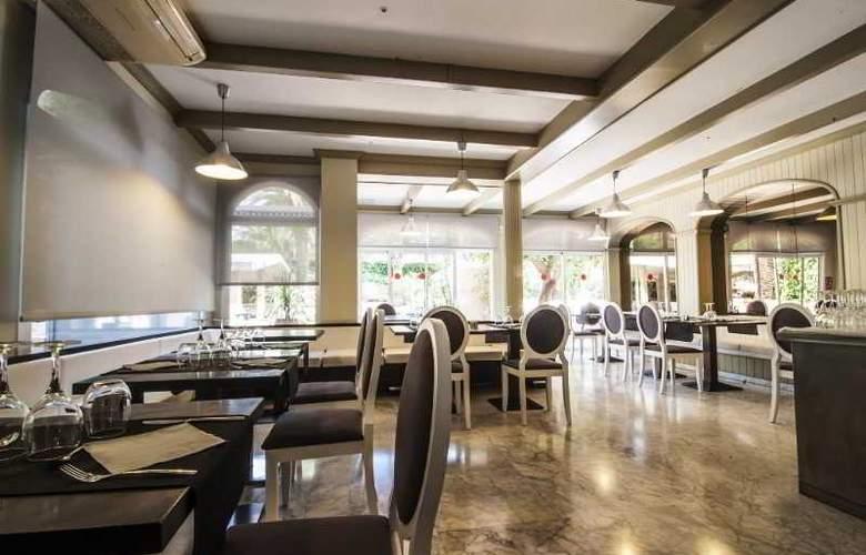Apartamentos Turísticos Royal Life - Restaurant - 25