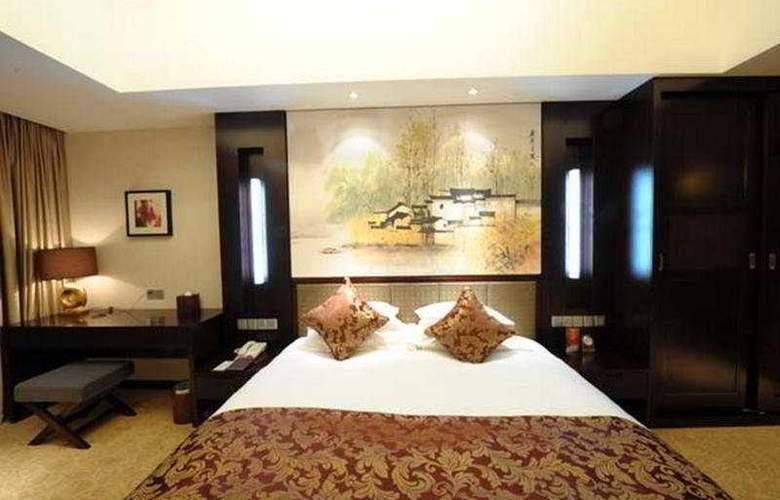 Gucun Park Hotel - Room - 2
