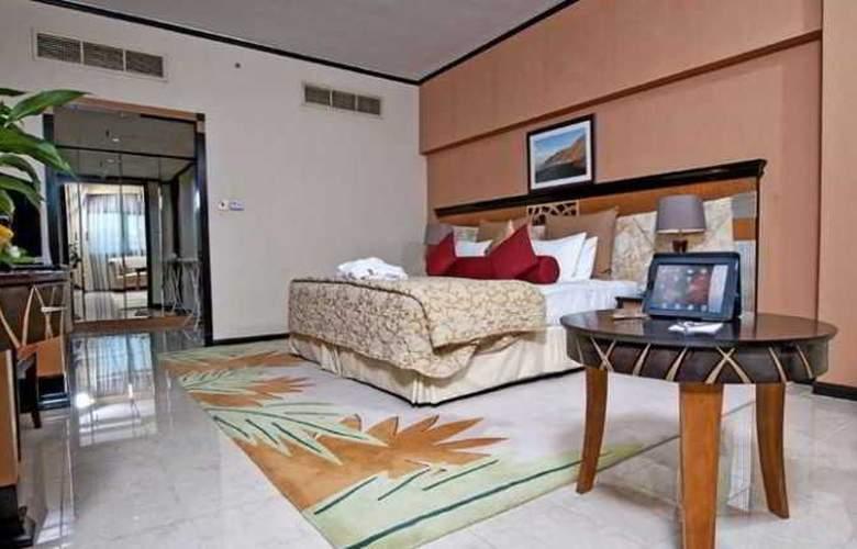 Al Jawhara Gardens - Room - 13