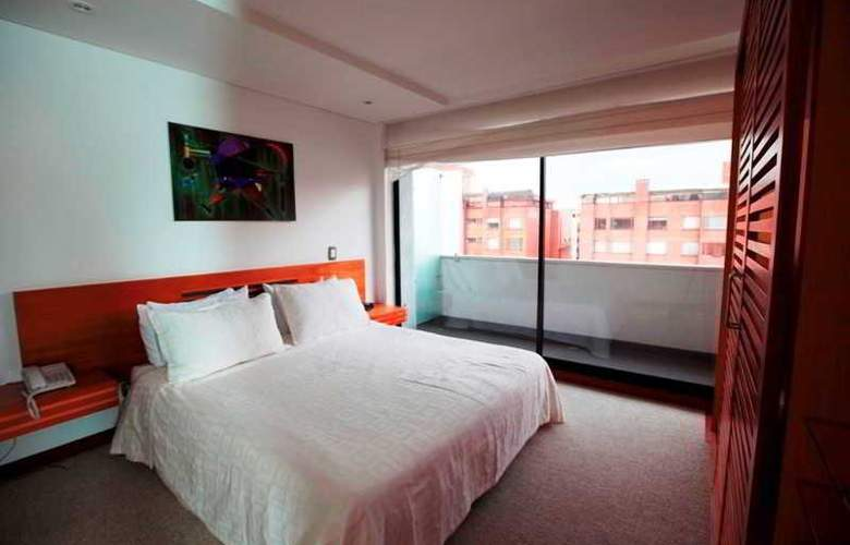 Travelers Apartamentos y Suites Obelisco - Room - 4