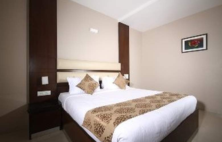 Mango Suites Brilliance - Room - 2