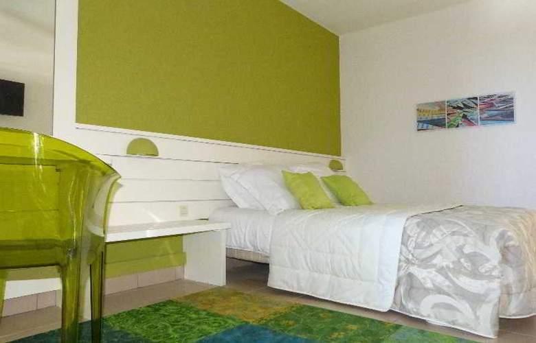 L´ Hotel les Aigrettes - Room - 6