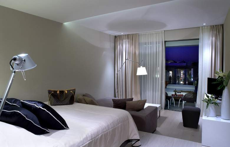 Pelagos Suites Hotel - Room - 1