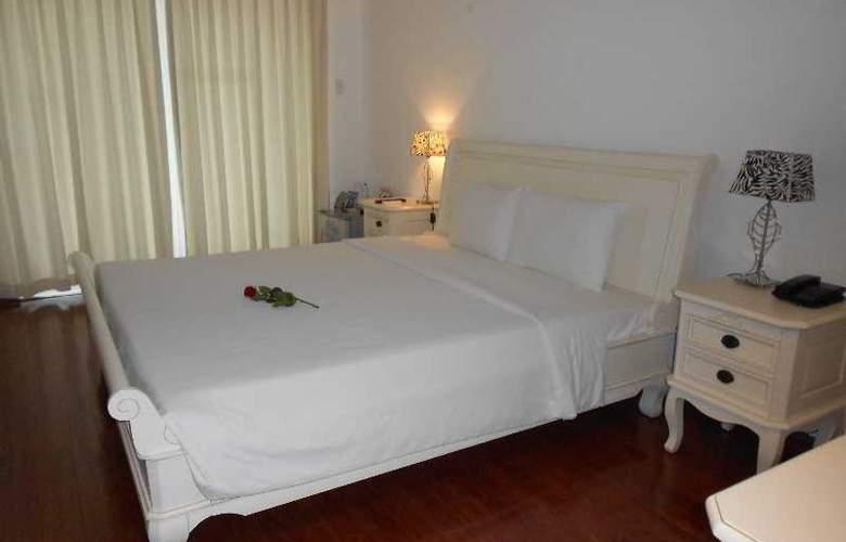 Paragon Villa Hotel - Room - 8