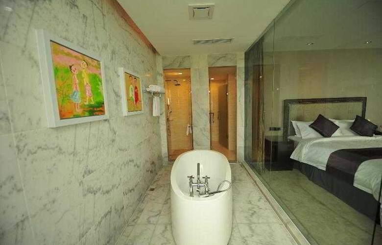 New Century ManJu Hotel - Room - 4