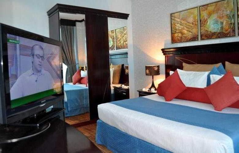 Al Jawhara Hotel Apartments - Room - 6