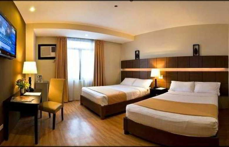 The Pinnacle Hotel and Suites - Room - 7