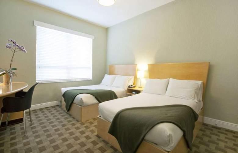 Crest Hotel Suites - Room - 10