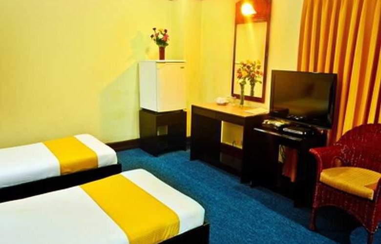 Paragon Suites - Room - 7