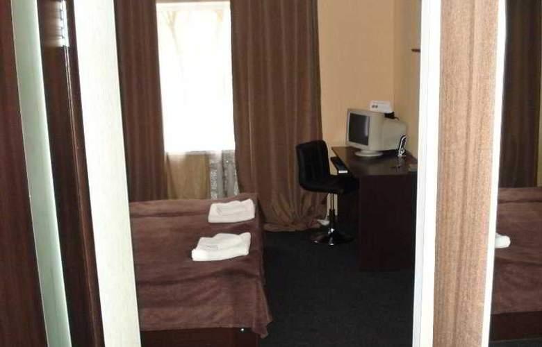 Ecotel Nivki - Room - 4