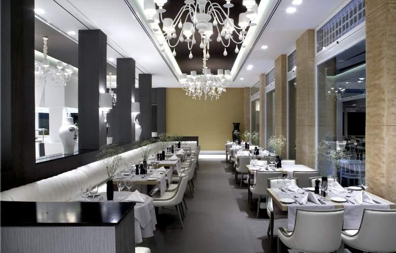 Pelagos Suites Hotel - Restaurant - 4