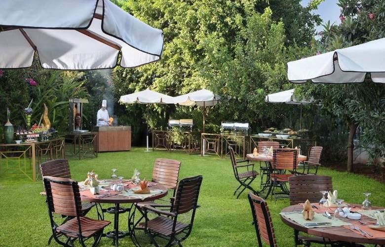 Tamar Rotana Hotel - Terrace - 6