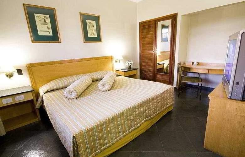 Nacional Plaza Inn - Room - 2