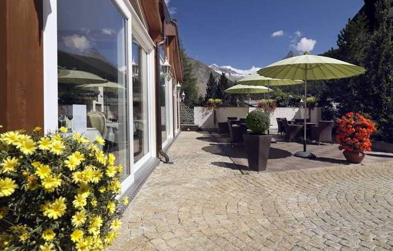 Schweizerhof Swiss Quality Gourmet- and SPA Hotel - Terrace - 7