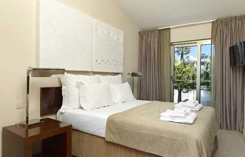Sao Rafael Villas & Apartments - Room - 19