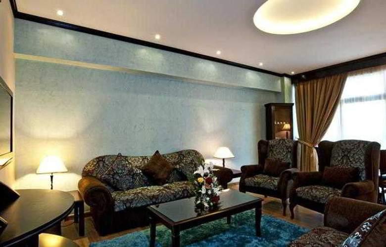 Al Jawhara Hotel Apartments - Room - 12