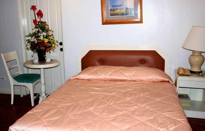 Lourdes Suites - Room - 9