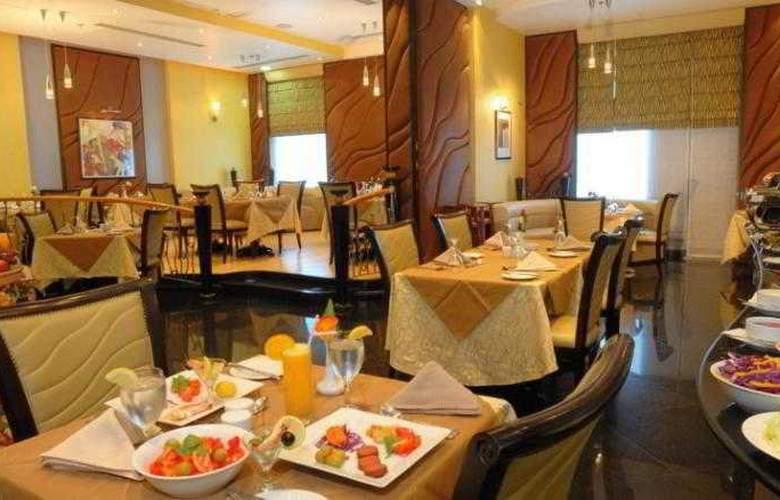 Al Jawhara Hotel Apartments - Restaurant - 9