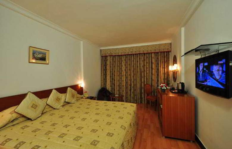 Ramee Guestline Hotel Bangalore - Room - 4