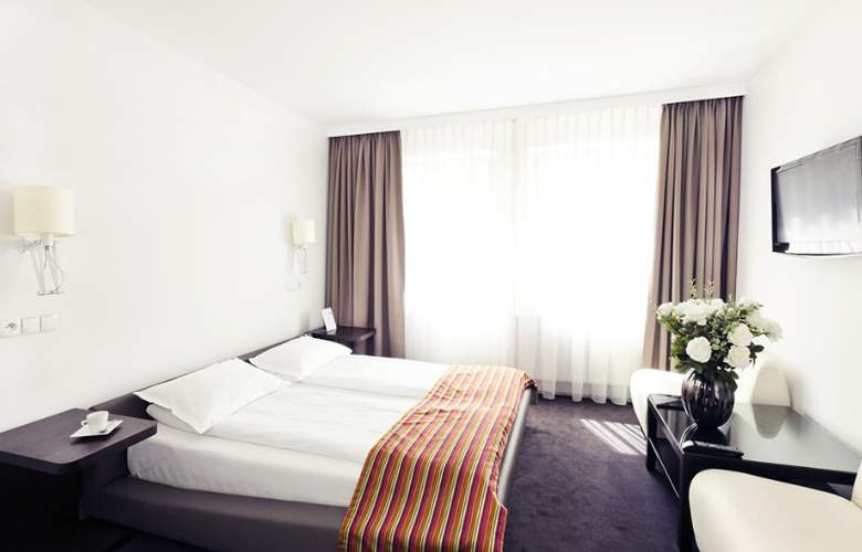 Platinum Palace Serviced Apartments Poznan - Room - 5