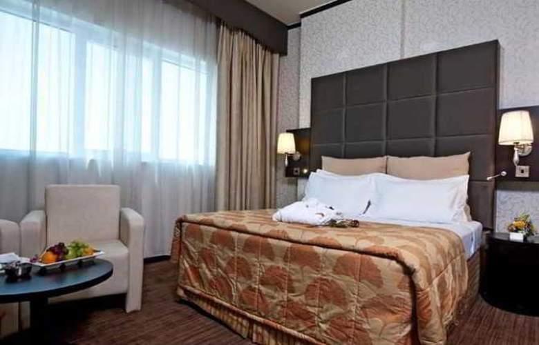Al Jawhara Gardens - Room - 11