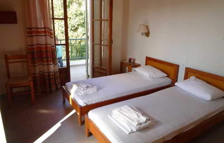 Haris Apartments - Room - 5