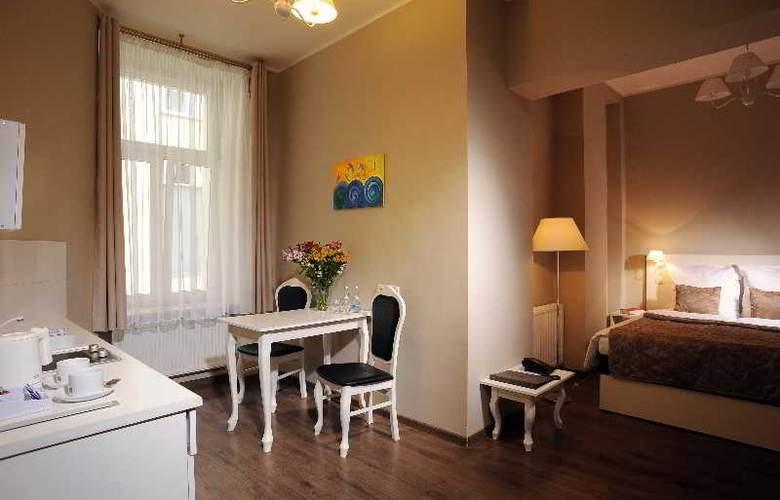 Aparthotel Leone - Room - 20