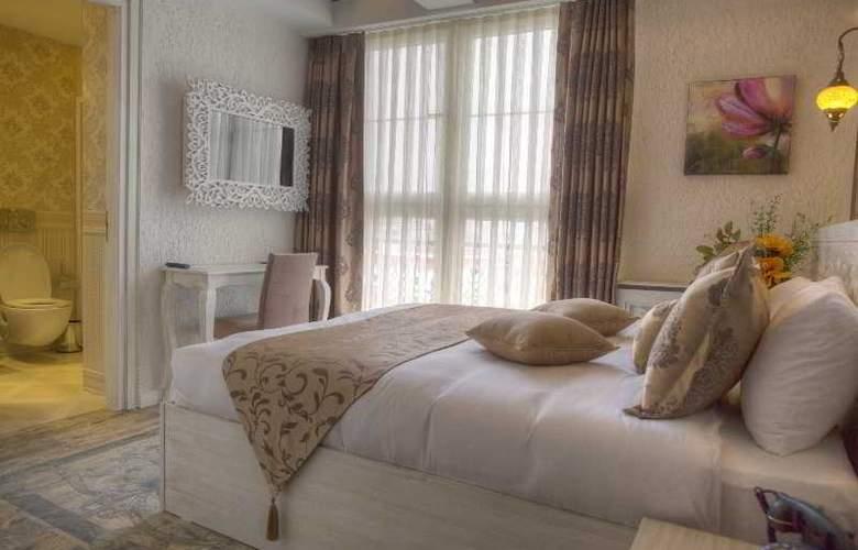 Elegance Asia Hotel - Room - 9